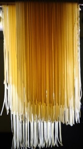 Fresh pasta, hanging to dry before cooking.