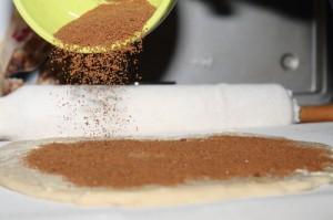 sprinkling on the cinnamon-sugar mix