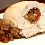 turkey roll with eggplant and tomato stuffing, cooked