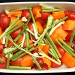 vegetables in casserole dish, ready to be roasted