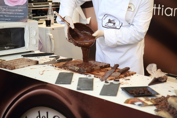 chocolate molds (perugina) being filled with tempered chocolate